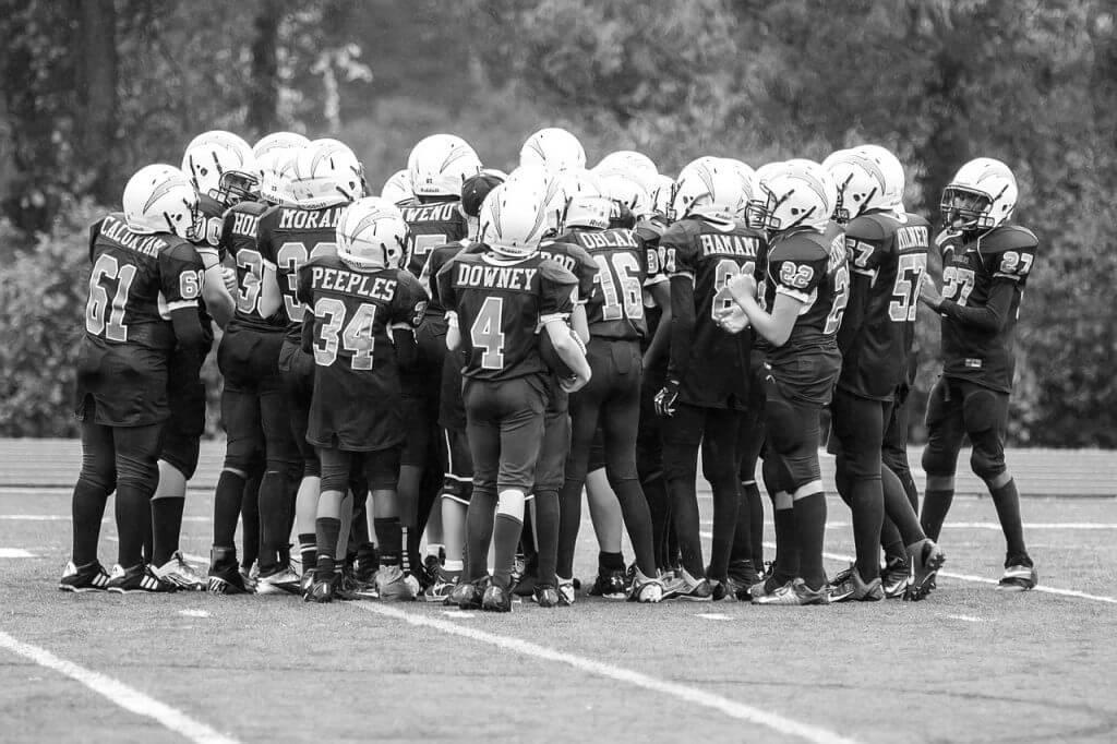 american football group huddle
